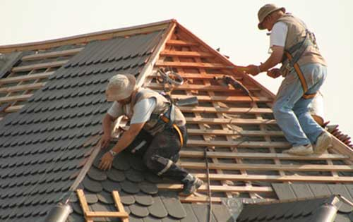 MRKed LLC Improvements Roofing and Gutters men shingling roof